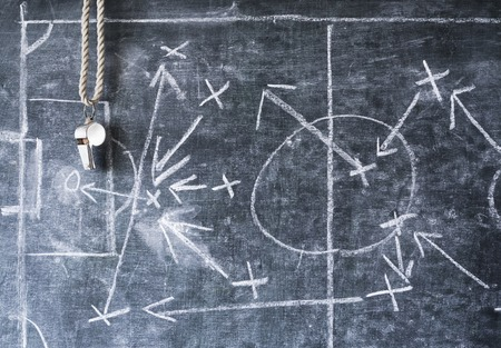 tactic: soccer or football tactical diagram,with silver whistle of coach or referee Stock Photo