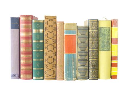 bibliomania: row of of books isolated on white background Stock Photo