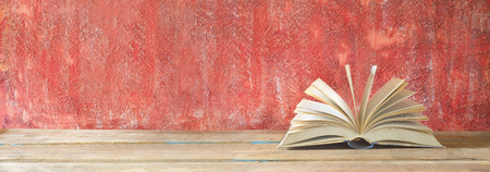 open book on red grungy background, good copy space Stok Fotoğraf - 81170961