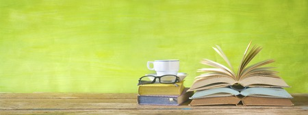 flipped books, cup of coffee,specs, reading, education,literature concept Stock Photo
