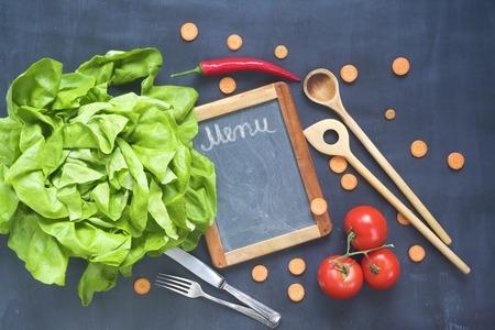 Food ingredients, kitchen utensils,blackboard for menu, flat lay, copy space Stock Photo