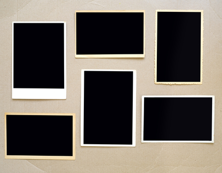 old empty photo frames, vintage photo prints on cardboard with free space for pictures