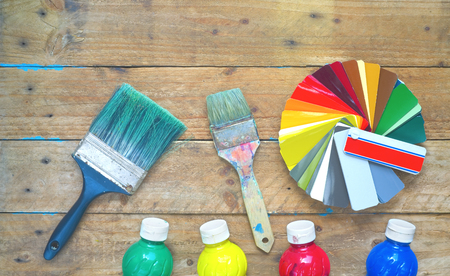 Paintbrushes, paint, color swatches, refurbishing, decorating, painting concept, flat lay