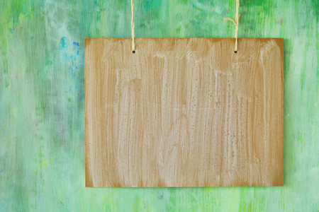 wooden signboard, hanging on grungy green wall, free copy space