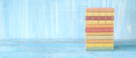 Stack of multicolored books, large panorama format, good copy space