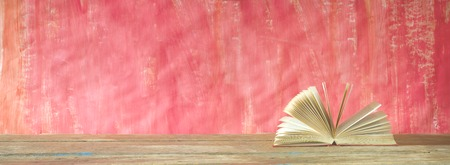 open book on red grungy background, good copy space Stock Photo