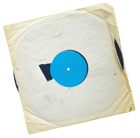 Old grungy vinyl record with yellowed inner sleeve, free copy space, isolated on white 免版税图像
