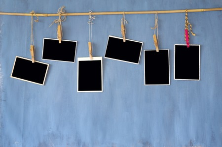 photo frames,  old blank photos on grungy wall, free space for your pics and copy Stock Photo