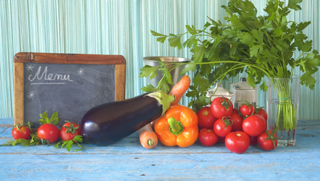 healthy food and kitchen blackboard. Dieting, healthy eating, vegetarian concept