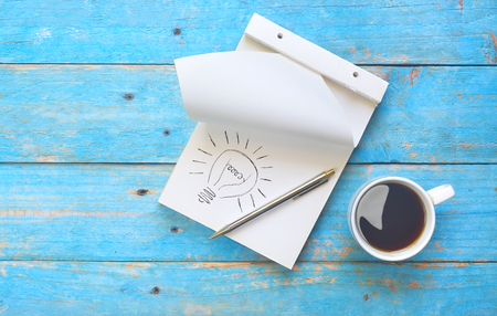 Idea concept with laptop, ball pen and cup of coffee, bright idea, inspiration, brainstorming concept
