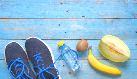 Fitness workout, running and reducing weight and healthy food concept,free copy space,flat lay