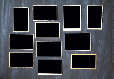 old empty photo frames, vintage photo prints on grungy background with free space for pictures Stock Photo