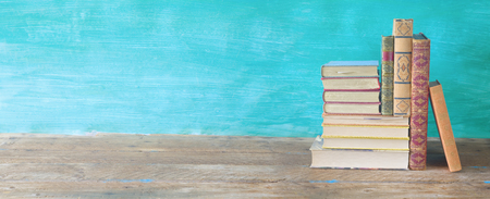 Arrangement of books, on painted background, large panorama format, good copy space