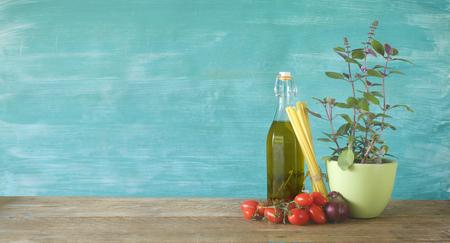 Ingredients for italian spaghetti dish, flavoured olive oil, pasta, tomatos, basil,onion, Stock Photo