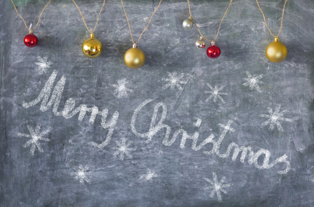 Christmas decoration on chalkboard, with lettering and Christmas tree balls Stock Photo