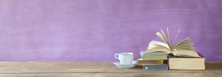 opened book, cup of coffee, panorama, good copy space Stock Photo