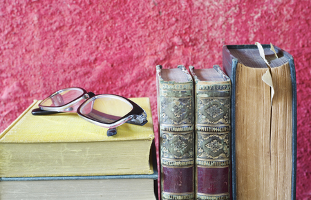 Vintage books and spectacles, close up, literature,reading,education concept, copy space