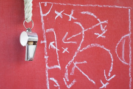 whistle of a soccer  football referee or trainer with tactical diagram scribble