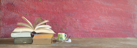 opened book, cup of espresso coffee, panorama, good copy space. Education, reading, literature concept Stock Photo