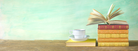 opened book, cup of coffee, panorama, good copy space. Education, reading, literature concept Stock Photo