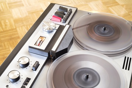 vintage open reel tape recorder in full operation, close up