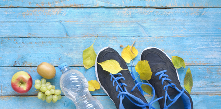 runnig and getting fit,  reducing weight in the autumn, pair of runners and fruit,free copy space,flat lay