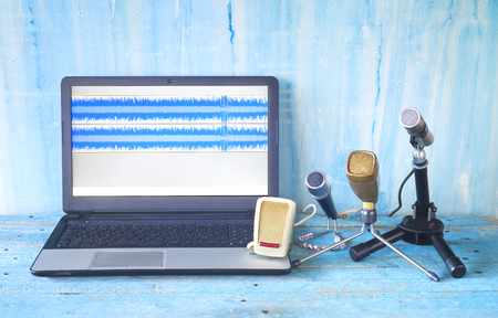 vintage microphones and laptop for recording podcasts or sound, grungy  background, good copy space