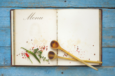 menu template, vintage cookbook with free copy space, spices and wooden spoons, flat lay. Stock Photo