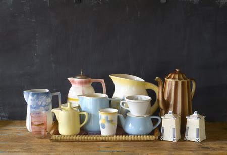 vintage tableware, coffee pots,mugs coffee filter on dark background, good copy space