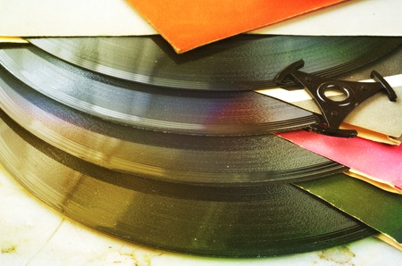 Stack of od vinyl records with yellowed sleeves, free copy space,