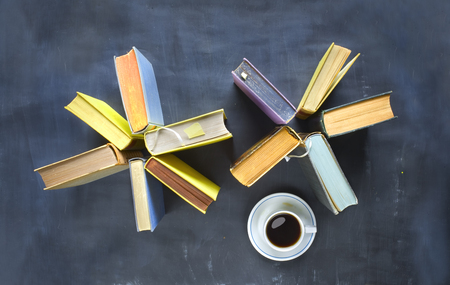 Arrangement of old books, cup of coffee, free copy space.Reading, learning, lterature concept. Flat lay. Stock Photo
