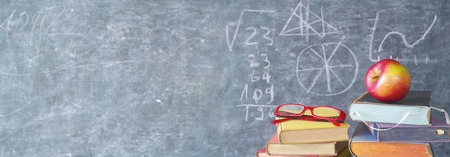 books, apple, specs in front of a black board, back to school, panoramic, free copy space