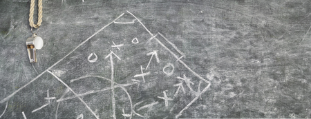 whistle of a soccer referee or trainer on blackboard w. tactical diagram,free copy space Stock Photo
