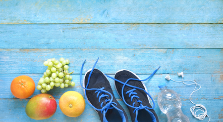 fitness, sport and reducing weight for the springtime, pair of runners and fruit,free copy space, flat lay