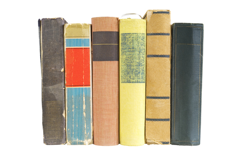 Row of old books, isolated on white background. Reading, learning, literature concept.