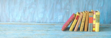 row of multicolored hardback books , panorama, reading education, literature, good copy space Stock Photo