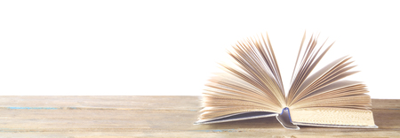 open book on white background, reading education,literature concept, panorama, good copy space Stock Photo