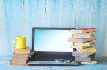 stacks of books, cup of coffee and laptop, learning, education, copy space Stock Photo