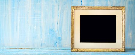 Empty vintage picture frame with free space for pics