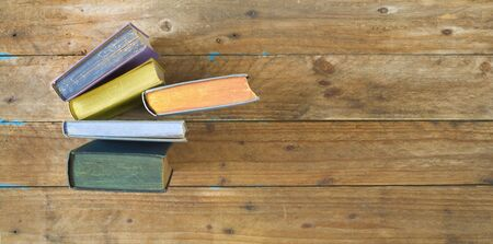 Arrangement of old multicolored books, flat lay, free copy space. Reading, learning, literature concept.