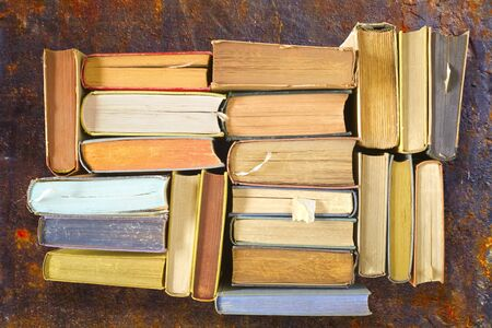 Multicolored books, flat lay, on rust background,reading, education, literature,learning Reklamní fotografie
