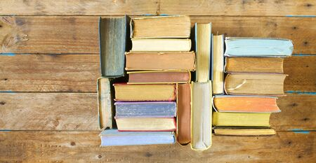 Multicolored books, flat lay, on wooden background, reading, education, literature,learning