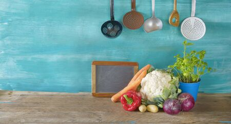 fresh cauliflower,vegetables,kitchen blackboard, utensils,food,cooking,eating concept,free copy space