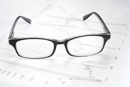 Share prices, stock exchange chart with spectacles, finance, business concept, close up
