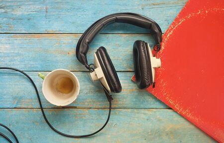 vintage headphone, vinyl record,cup of coffee, listening to music, mock up, free copy space
