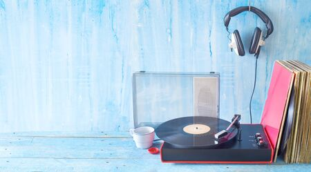 Old turntable, vinyl records, headphone, vintage audio gear, analog music concept, free copy space Reklamní fotografie