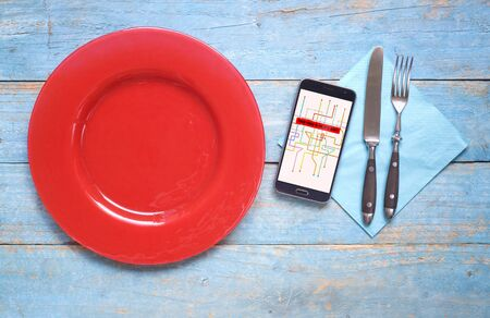 Food delivery concept, smartphone,plate,cutlery,delivery message on screen, free copy space 版權商用圖片