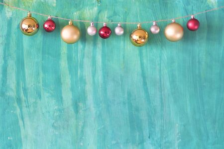 Christmas mock up with christmas balls and green painted background, free copy space