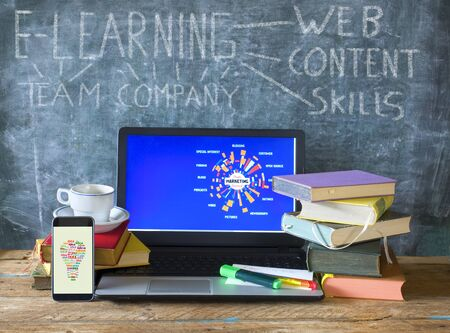 E_learning, advanced training, on-the-job training; education,school, achievement, concept, books, laptop,smartphone,black board Stock Photo - 129552119