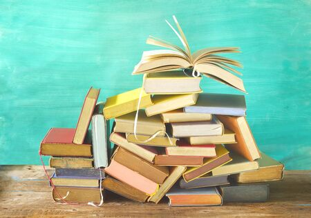 Open book on a pile of old books. Reading, learning, education, literature, good copy space